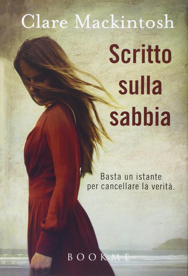 Il primo romanzo di Clare Mackintosh Scritto sulla sabbia con in copertina una ragazza vestita di rosso