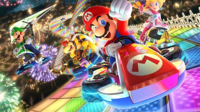 Mario e i suoi amici sfrecciano sulla Rainbow Road di Mario Kart 8 Deluxe