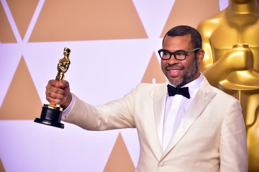 Il regista Jordan Peele durante la notte degli Oscar