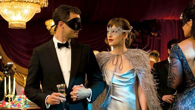 Mr Grey e Anastasia  in Cinquanta Sfumature di Nero