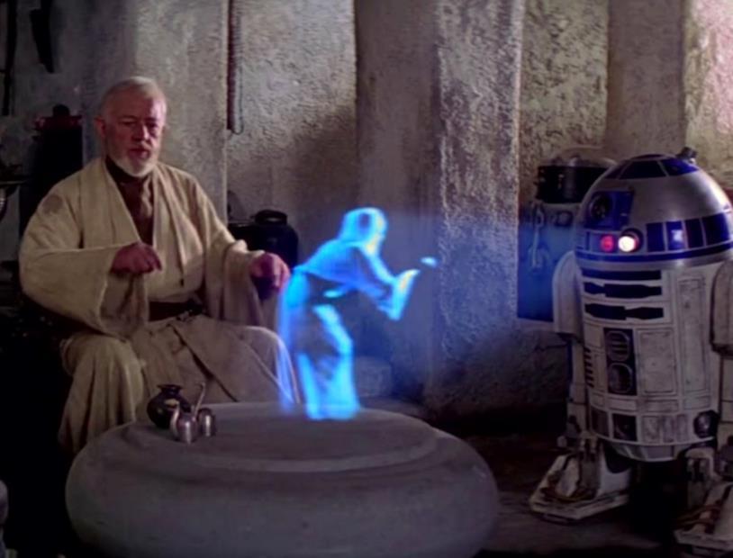 R2-D2 proietta l'ologramma della Principessa Leia in una scena di Star Was Episodio IV - Una nuova speranza