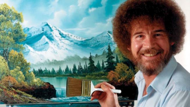 Bob Ross sorridente con uno dei suoi dipinti