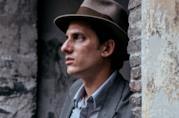 Luca Marinelli in una scena del film
