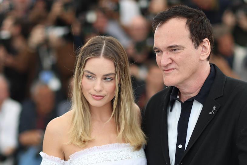 Margot Robbie e Quentin Tarantino posano per i fotografi
