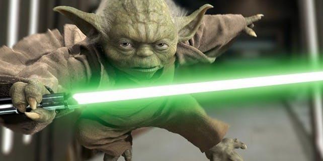 Yoda con la spada laser verde