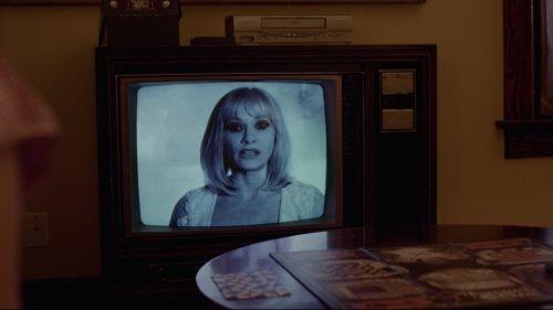 Gioco da tavolo e VHS in Beyond the Gates
