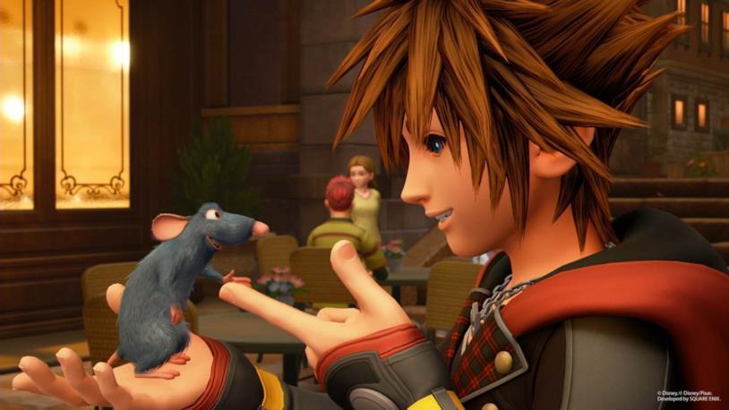 Un'immagine di gioco da Kingdom Hearts III che ritrae Remy da Ratatouille e Sora