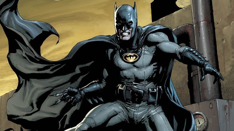 Batman a fumetti con il logo nero su fondo giallo e il mantello al vento