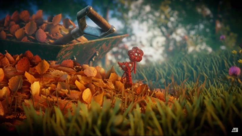Yarnie, il pupazzo di lana rossa protagonista del videogioco Unravel