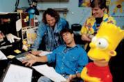 In foto David Silverman, due animatori e una gigantografia di Bart Simpson