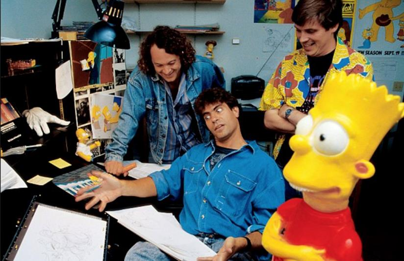 In foto David Silverman, due animatori e una gigantografia di Bart Simpson