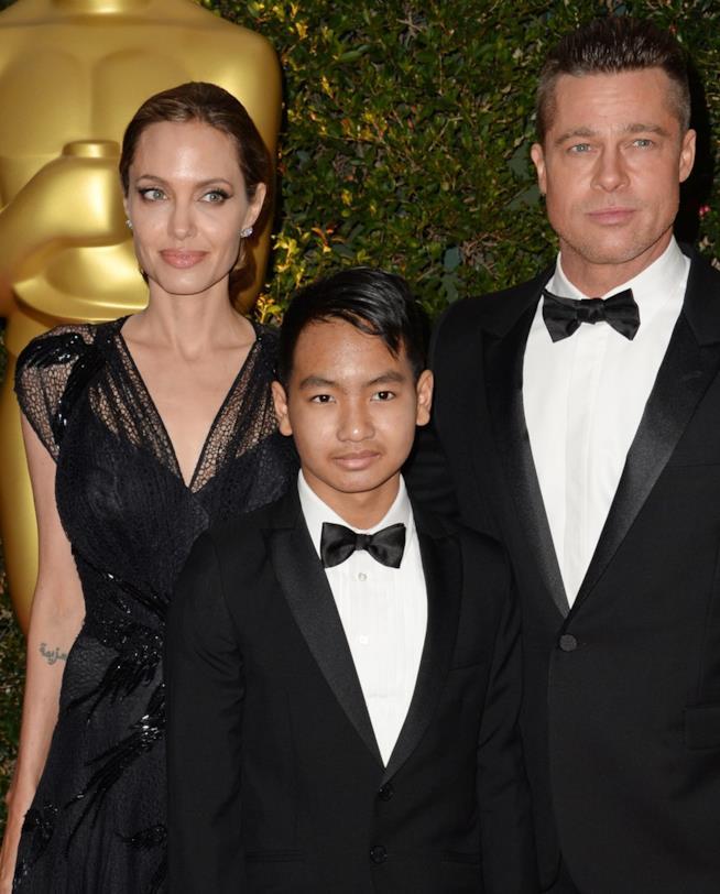 Brad Pitt e Angelina Jolie con il figlio Maddox