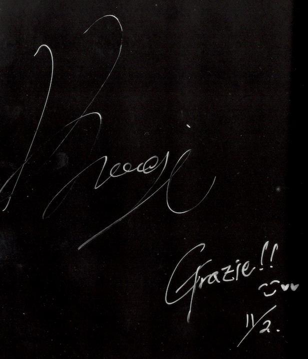 La firma di Koogi su un volume di Killing Stalking