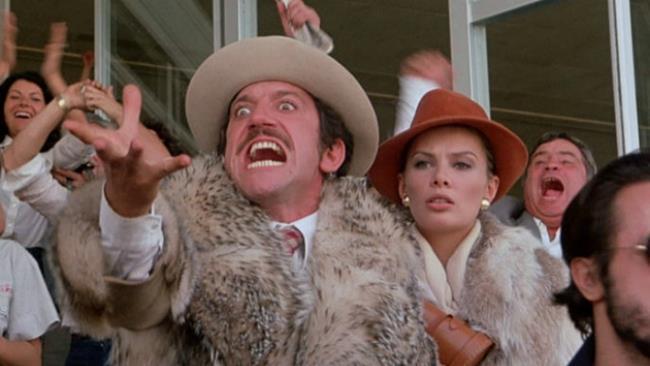 Gigi Proietti in una celebre scena del film