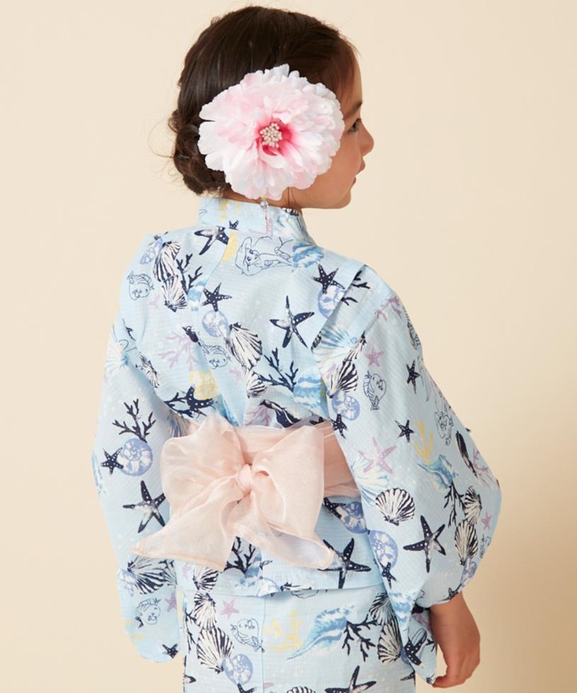 Il kimono di Ariel, la Sirenetta, contornato di conchiglie e stelle marine