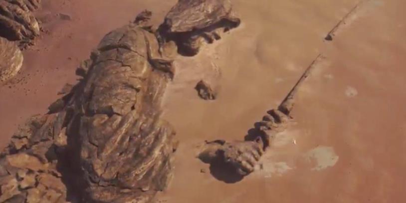 Una statua Jedi immersa nel terreno