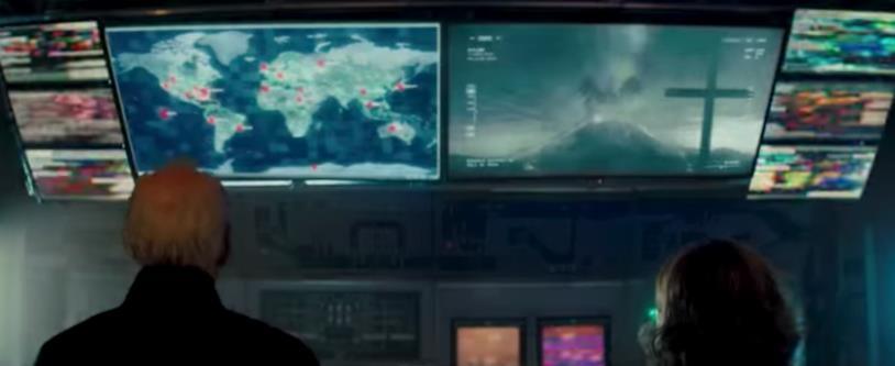 I personaggi di Mark Russell (a sinistra) e dott.ssa Emma Russell (a destra) che guardano i monitor in Godzilla: King of the Monsters