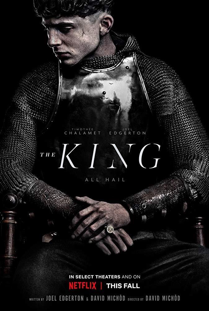Timothée Chalamet seduto sul trono nel poster de Il Re (The King)