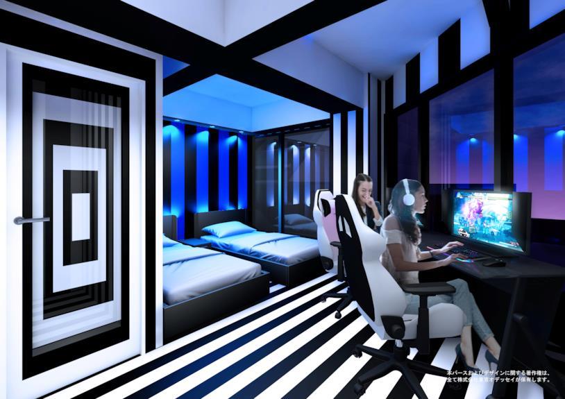 Un'immagine promozionale di una stanza dell'albergo E-Zone