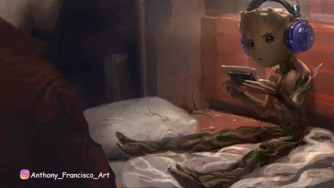 In foto Groot gioca al game-boy mentre guarda Star-Lord