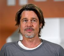 Un mezzo primo piano di Brad Pitt al photocall di C'era una volta... a Hollywood