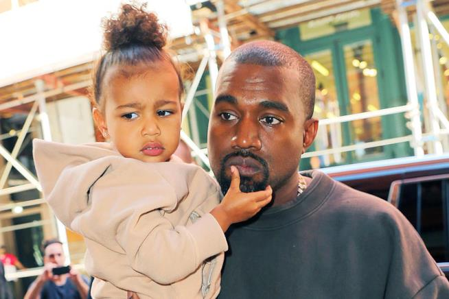 Primo piano di Kanye West e North West