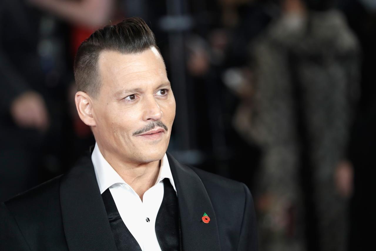 Johnny Depp in primo piano alla prima di Assassinio sull'Orient Express