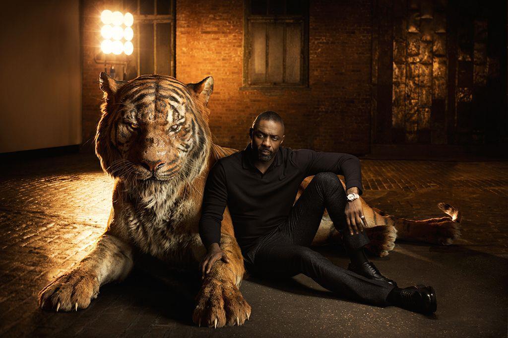 Idris elba e Shere Khan nel poster del Libro della Giungla