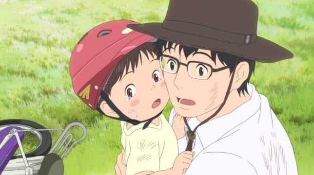 Kun piange tra le braccia del papà