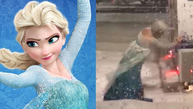Una drag queen di Boston vestita da Elsa inenta a spingere il van della polizia