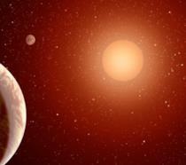 Illustrazione dei tre esopianeti che orbitano intorno a una nana rossa