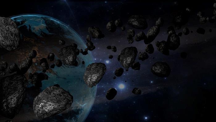 Una rappresentazione artistica di un gruppo di asteroidi vicino alla Terra