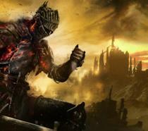 Un guerriero di fuoco impugna la sua spada nella cover art di Dark Souls III