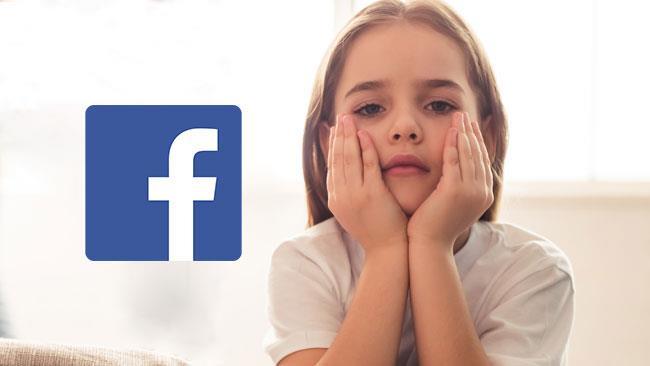 Il logo di Facebook al fianco di una ragazzina