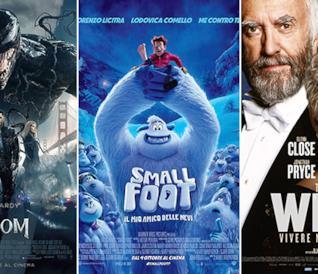 I poster dei film Venom, Smallfoot e The Wife - Vivere nell'ombra