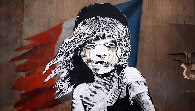 Il murales di Banksy dedicato ai migranti di Calais