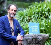 Il regista Luca Guadagnino in posa ad un'anteprima di Chiamami col tuo nome