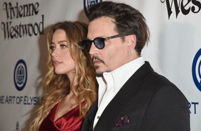 Johnny Depp con la ex moglie Amber Heard