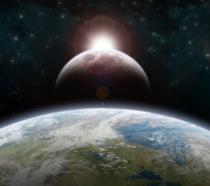 Il pianeta Terra e, di fronte ad esso, la Luna