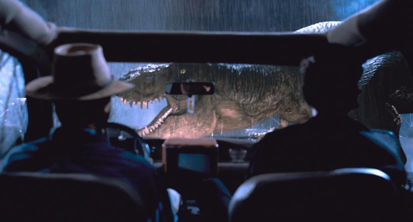 Alan Grant e Ian Malcolm assistono all'irruzione del sauro in Jurassic Park