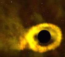 Un fotogramma del momento in cui un buco nero supermassiccio divora una stella