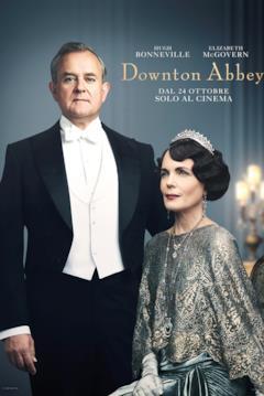 Robert e Cora Crawley nel poster ufficiale del film di Downton Abbey. Entrambi indossano eleganti abiti da sera, Cora spicca per la sua luccicante corona color argento abbinata al vestito