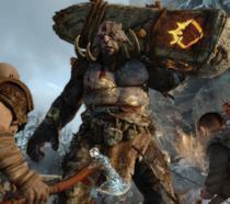 Kratos e il figlio combattono con un troll