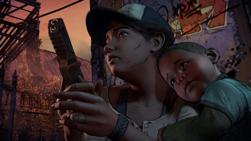 Clementine impugna la sua pistola in The Walking Dead - Season 3