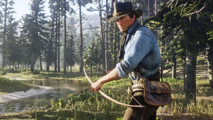 Arthur Morgan armato di arco e frecce in Red Dead Redemption 2