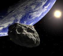 Una rappresentazione artistica di un asteroide in prossimità della Terra